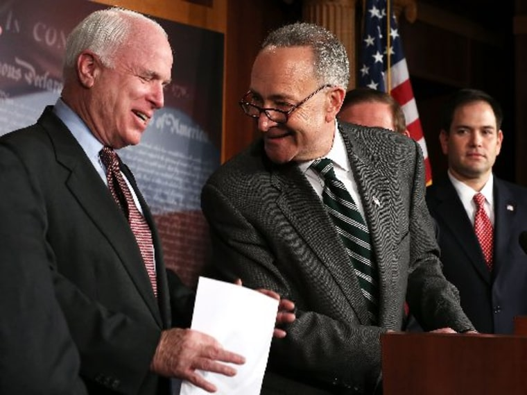 File photo: U.S. Sen. Charles Schumer (D-NY) (2nd L) and Sen. John McCain (R-AZ) (L) share a moment as Sen. Marco Rubio (R-FL) (R) looks on during a news conference on a comprehensive immigration reform framework January 28, 2013 on Capitol Hill in...