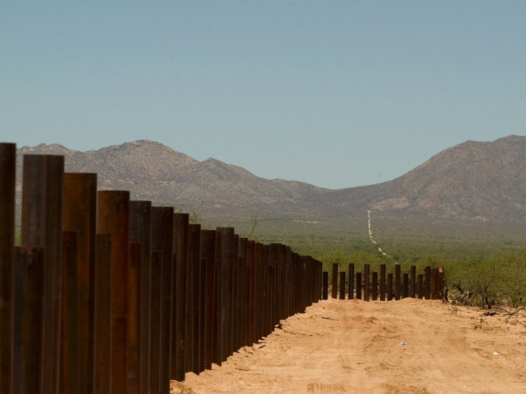 A new border fence is seen at the zone known as El Bajio, in Sasabe Arzn., Wednesday, May 23, 2007. El Bajio is one of the immigrants busiest crossing points. Democrats are seeking to slash the number of foreign workers who could come to the U.S. with...