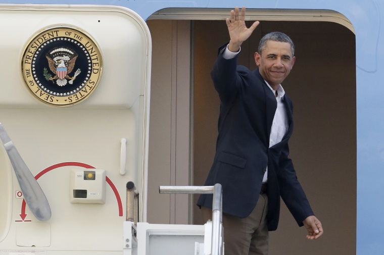 President Barack Obama waves from Air Force One as he leaves Palm Beach International Airport, Monday, Feb. 18, 2013. Obama spent the long Presidents Day weekend playing golf. (AP Photo/Wilfredo Lee)