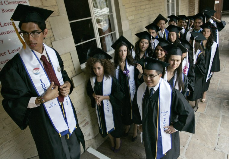 Image: Undocumented UCLA students attend graduation ceremony at a church near the campus in Los Angeles