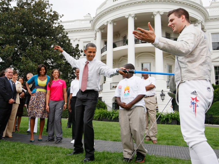 President Obama using light saber during an event on the South Lawn of the White House on Sept. 16, 2009. (File photo by Charles Dharapak/AP)