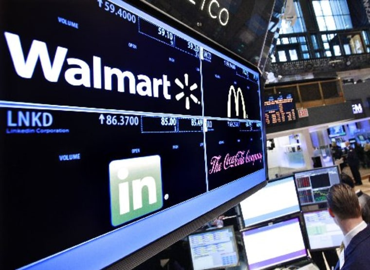 A board shows stock prices for Wal-Mart at the booth they are traded on the floor of the New York Stock Exchange, in this March 6, 2012 file photo. (REUTERS/Brendan McDermid/Files)