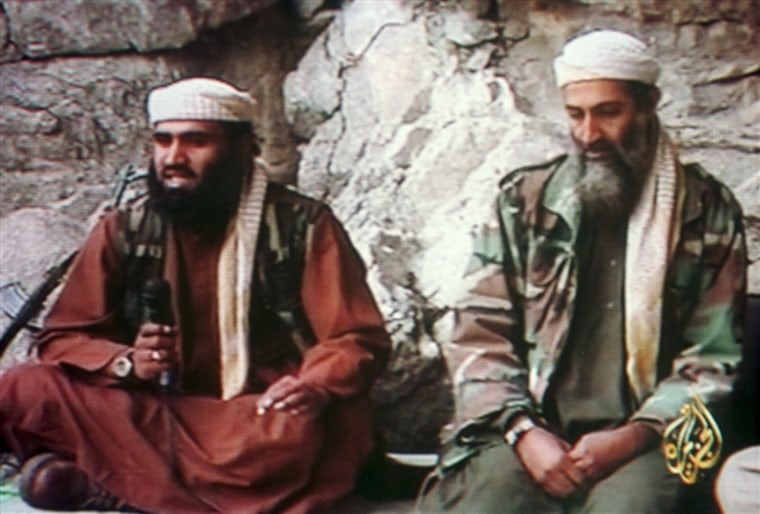 """Al-Qaida spokesman Sulaiman Abu Ghaith, left, and Osama bin Laden in a photo taken from a video and released by Al Jazeera in 2001. In the video, which emerged shortly after the 9/11 attacks, Abu Gaith said: \""""Americans should know the storm of planes..."""