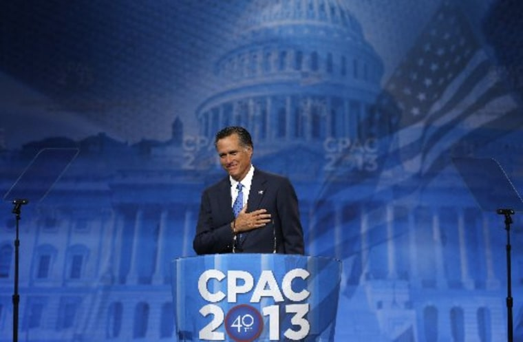 Former Republican Presidential candidate Mitt Romney puts his hand to his heart as supporters cheer him upon taking the stage to speak at the Conservative Political Action Conference (CPAC) at National Harbor, Maryland March 15, 2013.  REUTERS/Kevin...