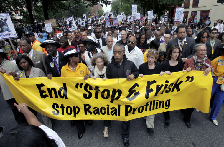"""The Rev. Al Sharpton, center, walks with demonstrators during a silent march to end the """"stop-and-frisk"""" program in New York, Sunday, June 17, 2012. Thousands of protesters from civil rights groups walked down New York City's Fifth Avenue in total..."""