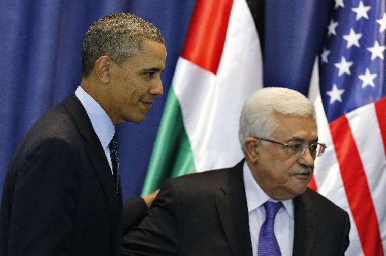 U.S. President Barack Obama (L) and Palestinian President Mahmoud Abbas leave after a joint news conference at the Muqata presidential compound in the West Bank city of Ramallah March 21, 2013. Obama said on Thursday that settlement building in the...