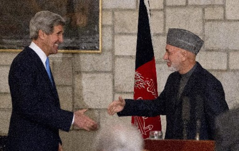 US Secretary of State John Kerry and Afghanistan's President Hamid Karzai shake hands at the end of their press conference at the Presidential Palace in Kabul, on March 25, 2013. Kerry scrapped a planned visit to Pakistan to avoid accusations of...