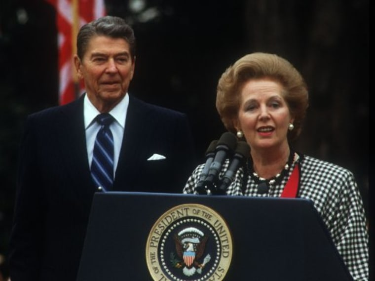 President Ronald Reagan watches as British Prime Minister Margaret Thatcher speaks on November 16, 1988, in Washington, D.C. Thatcher visits the White House to attend President Reagan's last state dinner. (Photo by Brad Markel/Liaison/Getty Images)
