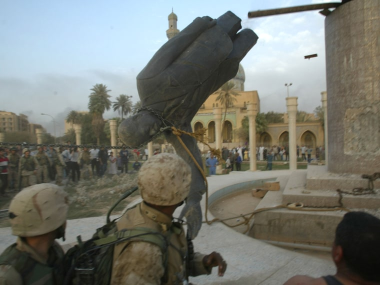 File Photo: U.S. Marines from the Marine 1st Division take down a Saddam Hussein statue April 9, 2003 in Baghdad, Iraq. (Photo by Robert Nickelsberg/Getty Images, File)