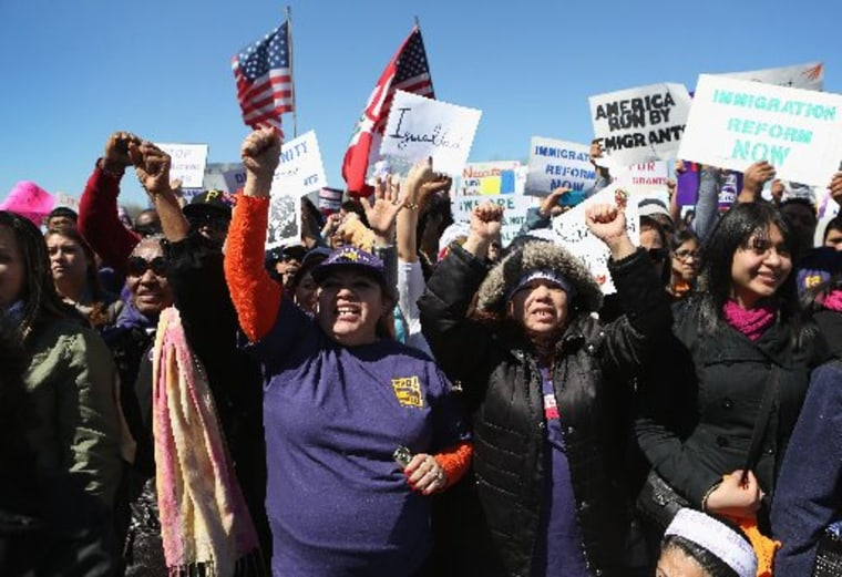 """Demonstrators cheer during a \""""Time is Now\"""" rally for immigration reform on April 6, 2013 in Jersey City, New Jersey. (Photo by John Moore/Getty Images)"""