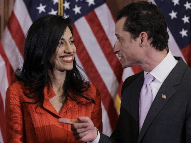 Rep. Anthony Weiner, D-N.Y., and his wife, Huma Abedin, aide to Secretary of State Hillary Rodham Clinton, are pictured after a ceremonial swearing in of the 112th Congress on Capitol Hill in Washington, Wednesday, Jan. 5, 2011. (AP Photo/Charles...