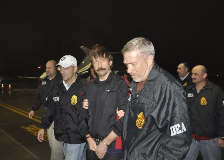 Suspected Russian arms dealer Viktor Bout (C) is escorted by Drug Enforcement Administration (DEA) officers after arriving at Westchester County Airport in White Plains, New York November 16, 2010. Bout maintained shell corporations in Delaware, taking...