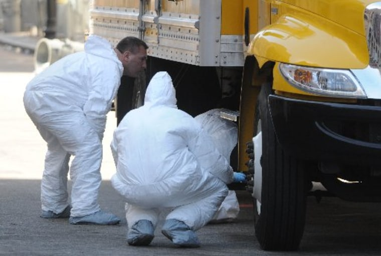BOSTON, MA - APRIL 17: FBI crime scene investigators search a truck left on Boylston Street just past Berkeley Street April 17, 2013 in Boston, Massachusetts.  Investigators continue to work the scene of two bomb explosions at the finish line of the...