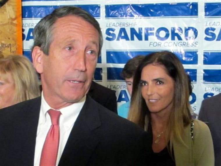 Former South Carolina Gov. Mark Sanford, with his fiancee Maria Belen Chapur. (AP Photo/Bruce Smith)