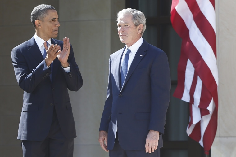 President Barack Obama stands with former president George W. Bush at the dedication of the George W. Bush presidential library on the campus of Southern Methodist University in Dallas, Thursday, April 25, 2013. (AP Photo/Charles Dharapak)