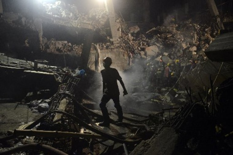 A worker leaves the site where a garment factory building collapsed near Dhaka, Bangladesh Monday, April 29, 2013. (AP Photo/Ismail Ferdous)