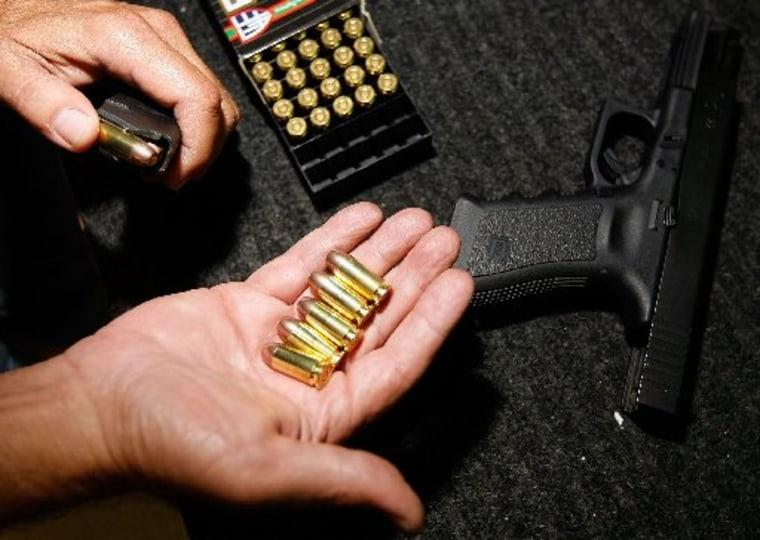 40mm pistol on the table at the Pembroke Gun & Range shop on April 9, 2009 in Pembroke Park, Fla.