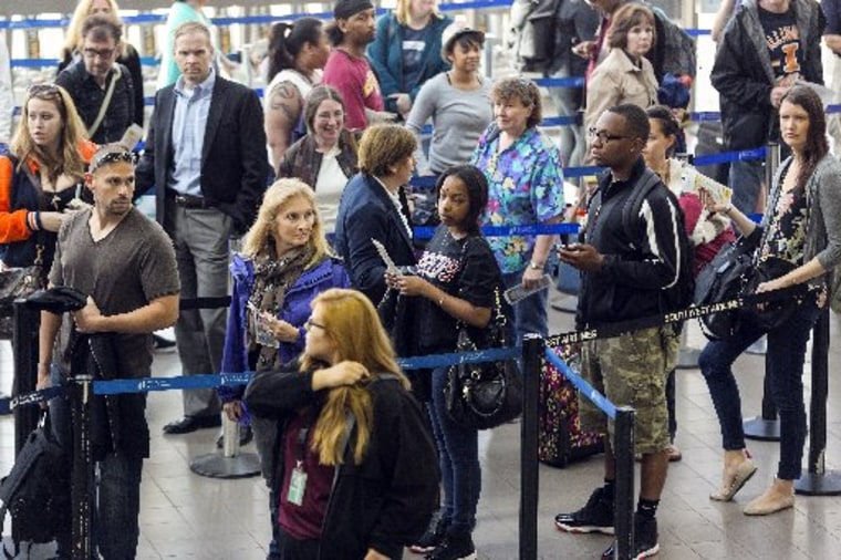 Travelers stand in line at Los Angeles International airport in Los Angeles Monday, April 22, 2013. The FAA said late Sunday night that staffing cuts were causing delays averaging more than three hours for flights arriving at Los Angeles International...