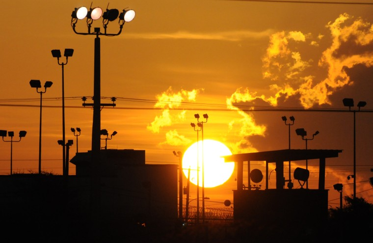 In this photo reviewed by the U.S. Department of Defense, towers overlooking a U.S. detention facility are silhouetted against a morning sunrise at Guantanamo Bay U.S. Naval Base, Cuba, Thursday, Oct. 18, 2012.  (AP Photo/Toronto Star, Michelle...