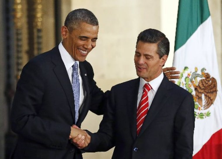 U.S. President Barack Obama (L) shakes hands with his Mexican counterpart Enrique Pena Nieto after a joint news conference at the National Palace in Mexico City May 2, 2013. Obama arrived in Mexico on Thursday for a visit he hopes will draw attention...