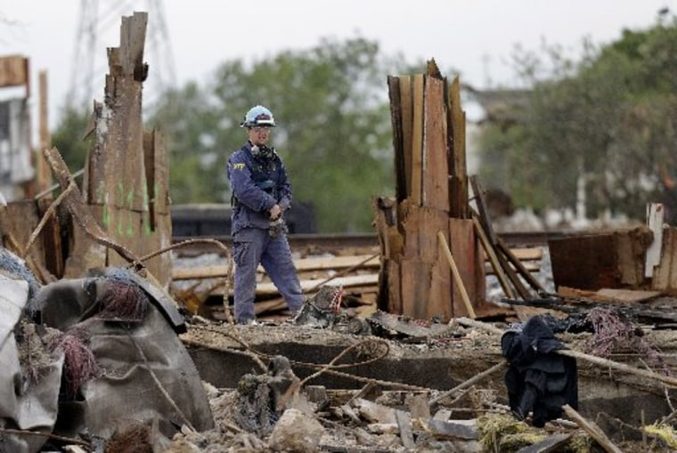 An investigator looks over a destroyed fertilizer plant in West, Texas, Thursday, May 2, 2013. Investigators face a slew of challenges in figuring out what caused the explosion at the fertilizer plant that killed 14 people and destroyed part of the...