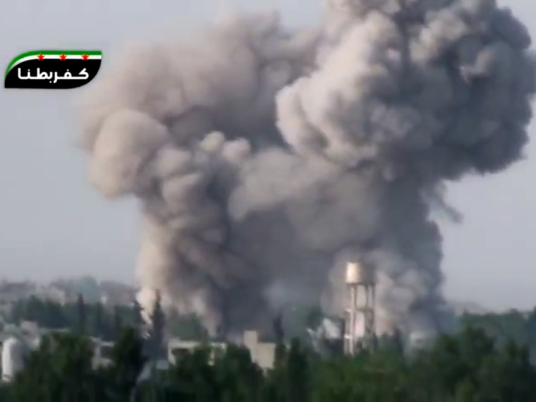 In this image taken from video obtained from the Ugarit News, which has been authenticated based on its contents and other AP reporting, smoke billows from a government airstrike on the Ghouda area of Damascus, Syria, Friday, May 3, 2013. Syria's main...