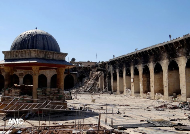 This journalism image provided by Aleppo Media Center AMC which has been authenticated based on its contents and other AP reporting, shows the damaged famed 12th century Umayyad mosque without the minaret, background right corner, which was destroyed...