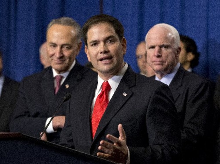 """Sen. Marco Rubio, R-Fla., flanked by Sen. Charles Schumer, D-N.Y., left, and Sen. John McCain, R-Ariz., right, speaks about immigration reform legislation as outlined by the Senate's bipartisan """"Gang of Eight"""" April 18, 2013, on Capitol Hill in..."""