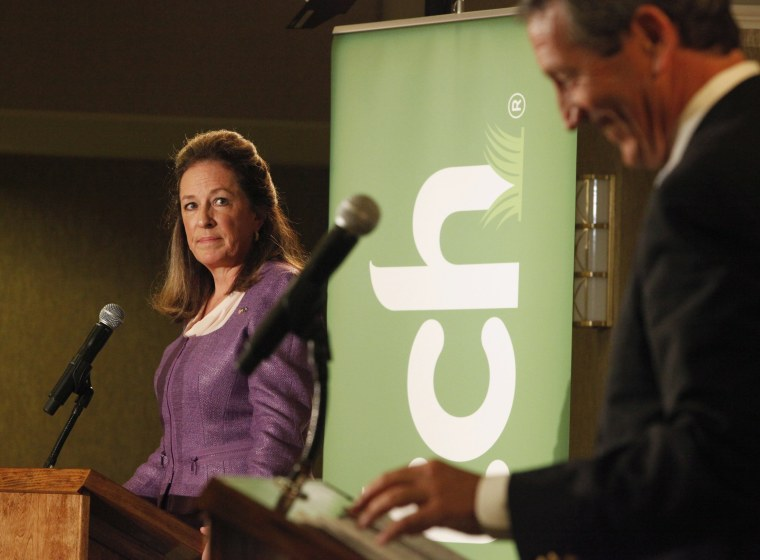 Democrat Elizabeth Colbert Busch looks over at former South Carolina Governor Mark Sanford during the South Carolina 1st Congresional debate in Charleston, South Carolina April 29, 2013. (Photo by Randall Hill/Reuters)