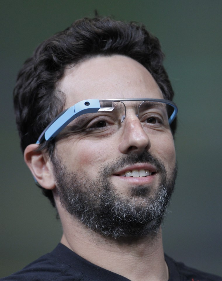 Google co-founder Sergey Brin demonstrates Google's new Glass, wearable internet glasses, at the Google I/O conference in San Francisco, Wednesday, June 27, 2012.  (AP Photo/Paul Sakuma)