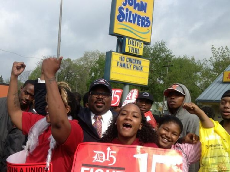 Fast food workers and Reverend Charles Williams II (center) picket a Long John Silver's in Detroit, Mich. on May 10, 2013. (Photo courtesy of Suzette Hackney, D15 coalition.)