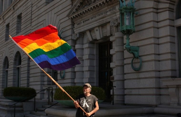 Bob Sodervick waves a rainbow flag outside the U.S. Courthouse in San Francisco, California in this June 5, 2012, file photo. (REUTERS/Robert Galbraith/Files)