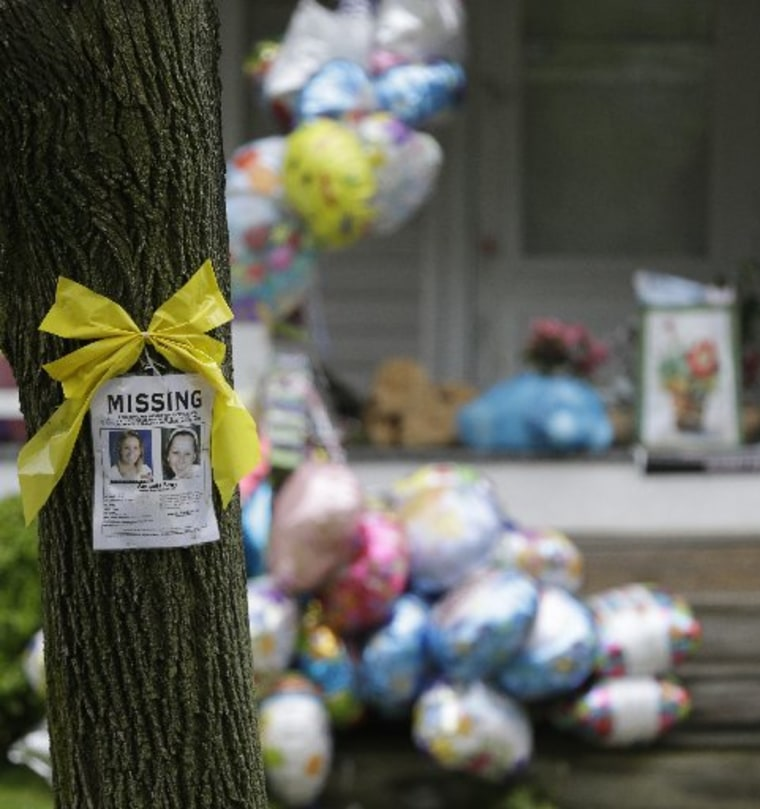 File Photo: A missing poster still hangs on a tree at the home where Amanda Berry is staying in Cleveland on Saturday, May 11, 2013. (Photo by: Tony Dejak/AP Photo)