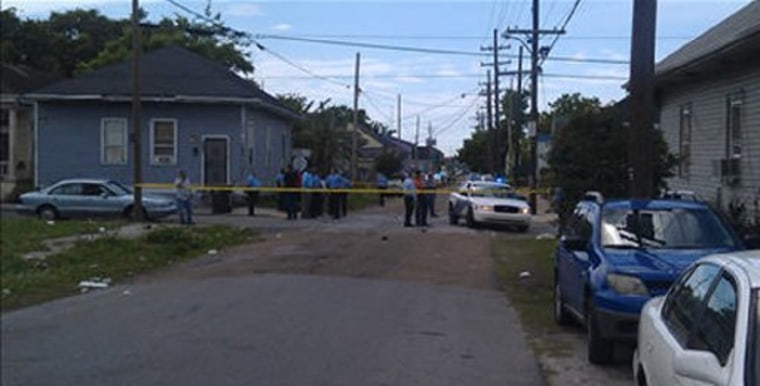 New Orleans Police Department members are seen at the site of a shooting of at least 12 people during a Mother's Day parade in New Orleans, Louisiana, May 12, 2013. (Photo via Fox 8 News)