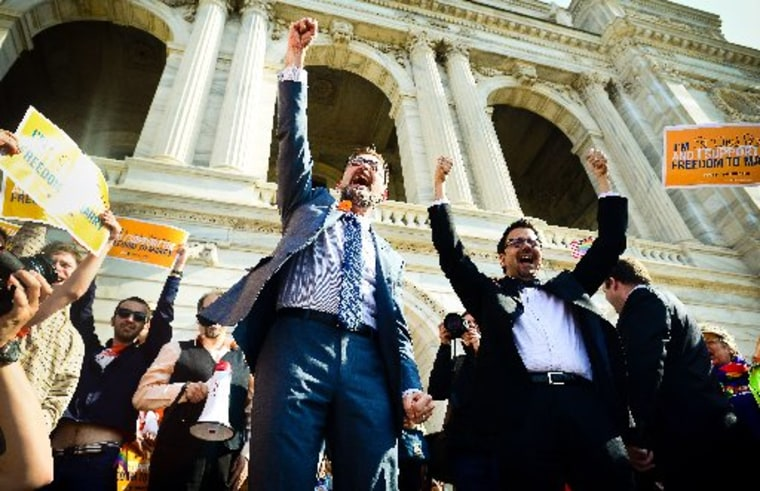 Sen. Scott Dibble, DFL-Minneapolis, left, sponsor of the gay marriage bill in the Minnesota Senate, and his partner Richard Leyva greet a large, joyous crowd as the arrive at the Minnesota State Capitol in St. Paul, Minn. on Monday, May 13, 2013. The...