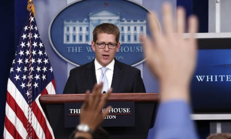Hands are raised as White House Press Secretary Jay Carney speaks to reporters in the briefing room of the White House in Washington May 14, 2013. The White House, under pressure over reports that the Department of Justice tracked Associated Press...