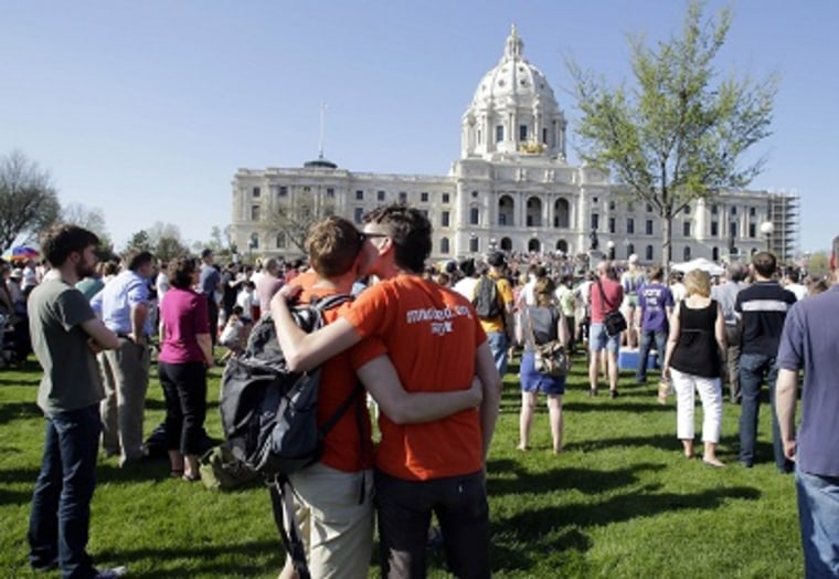 A crowd gathers at the State Capitol where Minnesota Gov. Mark Dayton signed the gay marriage bill, Tuesday, May 14, 2013, in St. Paul, Minn. (Photo by Jim Mone/AP)