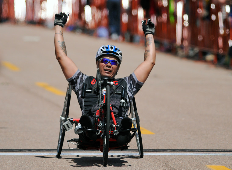 May 12, 2013: Marine Corps wounded warrior, Ronnie Jimenez, celebrates his handcycling victory during the first day of Warrior Games competition at the United States Air Force Academy, Colorado Springs, Colorado. Over 260 injured and disabled service...