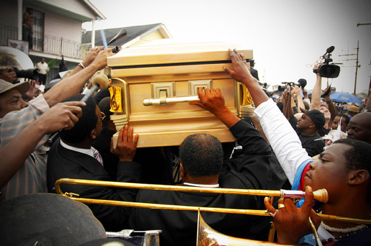 Mourners carry the casket of Dinerral Shavers, 25, who died from a gunshot to the back of his head in New Orleans, Sat., Jan. 6, 2007. Shavers was the snare drummer for the Hot 8 Brass Band and the music teacher at L.E. Rabouin High School, where he...