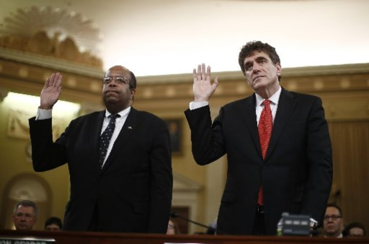 Outgoing acting IRS Commissioner Steven Miller (R) and Treasury Inspector General for Tax Administration (L). Russell George are sworn-in during a House Ways and Means Committee hearing on the Internal Revenue Service targeting conservative groups on...