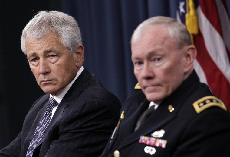 U.S. Secretary of Defense Chuck Hagel (L) and Joint Chiefs of Staff General Martin Dempsey hold a joint news conference at the Pentagon in Washington March 17, 2013.  (Photo by Yuri Gripas/Reuters)