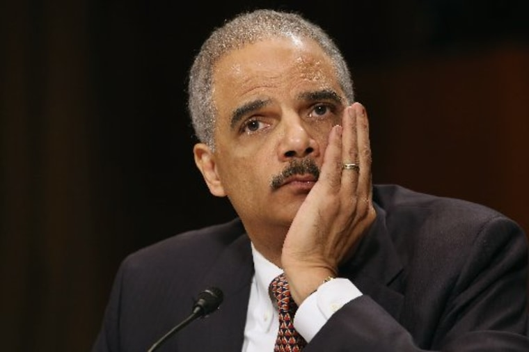File Photo: U.S. Attorney General Eric Holder testifies before the Senate Judiciary Committee on Capitol Hill March 6, 2013 in Washington, DC. (Photo by: Chip Somodevilla/Getty Images)