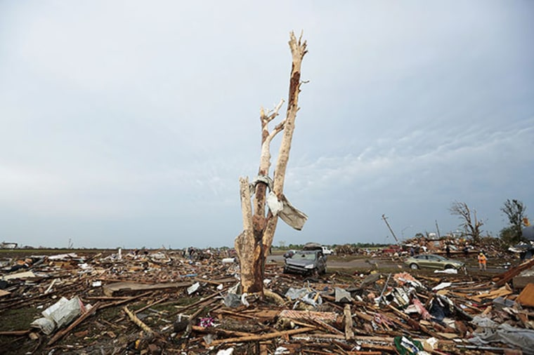 Debris covers the ground after a powerful tornado ripped through the area on May 20, 2013 in Moore, Oklahoma. (Photo by Brett Deering/Getty Images)