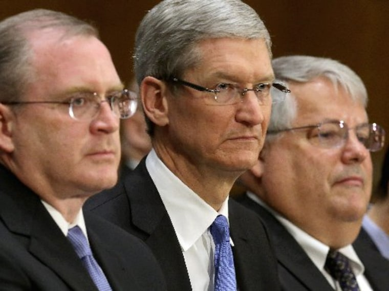 (L-R) Apple head of tax operations Phillip Bullock, Apple CEO Timothy Cook and Apple Senior Vice President and CFO Peter Oppenheimer prepare to testify before the Senate Homeland Security and Governmental Affairs Committee's Investigations Subcommittee...