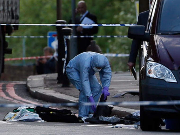 A police forensics officer investigates a crime scene where one man was killed in Woolwich, southeast London on May 22, 2013. (Photo by Stefan Wermuth/Reuters)