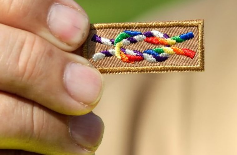 WASHINGTON, DC - MAY 22:  A member of Scouts for Equality holds an unofficial knot patch incorporating the colors of the rainbow, a symbol for gay rights(Photo by Win McNamee/Getty Images)