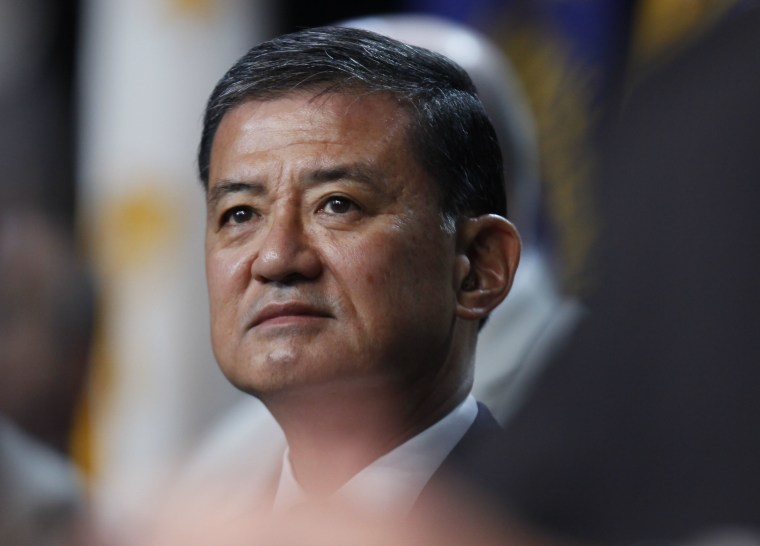 In this photo taken Aug. 2, 2010, Veterans Affairs Secretary Eric Shinseki listens to President Barack Obama speak about Iraq and Afghanistan at the Disabled American Veterans national convention in Atlanta. (AP Photo/Charles Dharapak)