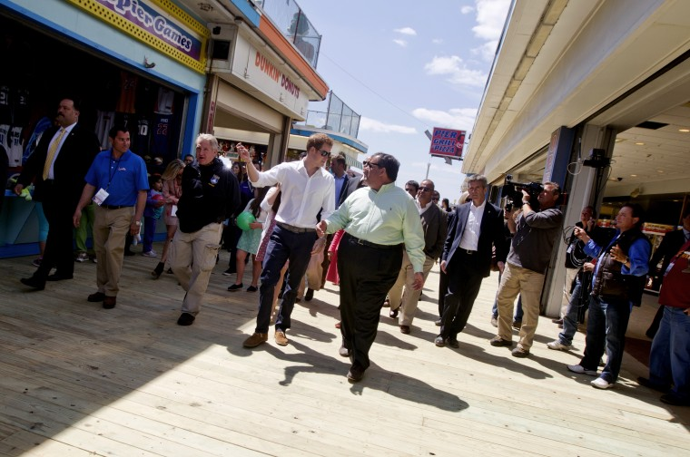 Britians Prince Harry and N.J. Gov. Chris Christie walk the new boardwalk in Seaside Heights during a tour of areas of Ocean County that suffered extensive damage during Hurricane Sandy on Tuesday, May 14, 2013.  Prince Harry began a tour  of New...