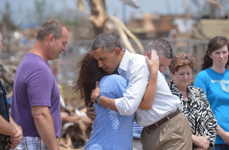 President Barack Obama is greeted as he tours a tornado affected area on May 26, 2013 in Moore, Oklahoma. (Photo by: Mandel/AFP Getty Images)