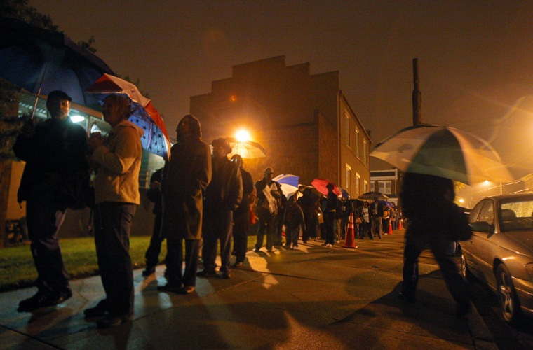 File photo: Voters line up before 6 a.m. outside the City Hall East voting precinct in Richmond, Va., on Tuesday, November 4, 2008. (Eva Russo)